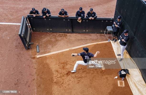 Masahiro Tanaka of the New York Yankees warming up in the bullpen prior to the spring training game against the Washington Nationals at Steinbrenner...