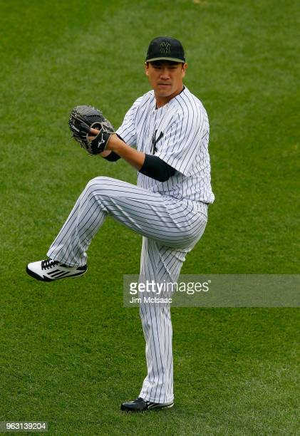 Masahiro Tanaka of the New York Yankees warms up before a game against the Los Angeles Angels of Anaheim at Yankee Stadium on May 27 2018 in the...
