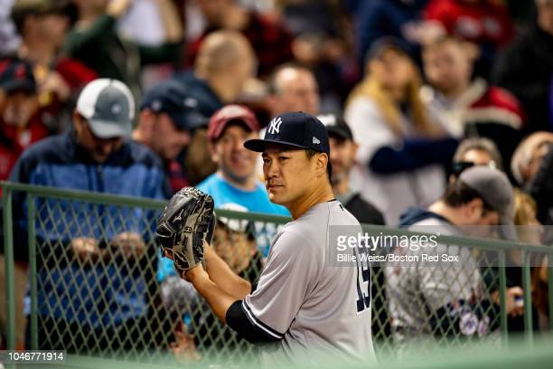 Masahiro Tanaka of the New York Yankees warms up before game two of the American League Division Series against the Boston Red Sox on October 6 2018...