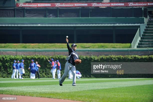 Masahiro Tanaka of the New York Yankees warms up before the game against the Chicago Cubs on May 21 2014 at Wrigley Field in Chicago Illinois