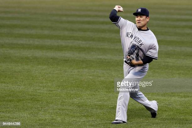 Masahiro Tanaka of the New York Yankees warms up before the game against the Boston Red Sox at Fenway Park on April 11 2018 in Boston Massachusetts