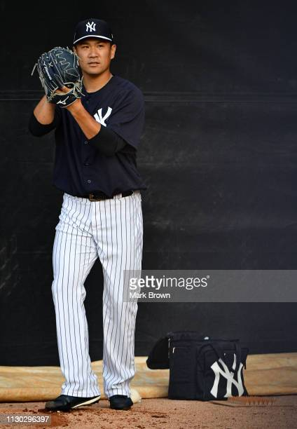 Masahiro Tanaka of the New York Yankees warms up before the spring training game against the Philadelphia Phillies at Steinbrenner Field on March 13...