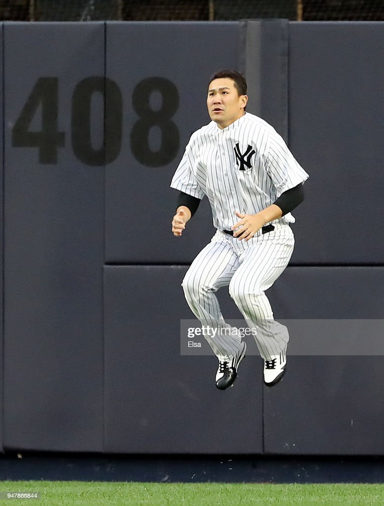Masahiro Tanaka #19 of the New York Yankees warms up in the outfield before the game against the Miami Marlins at Yankee Stadium on April 17, 2018 in the Bronx borough of New York City.