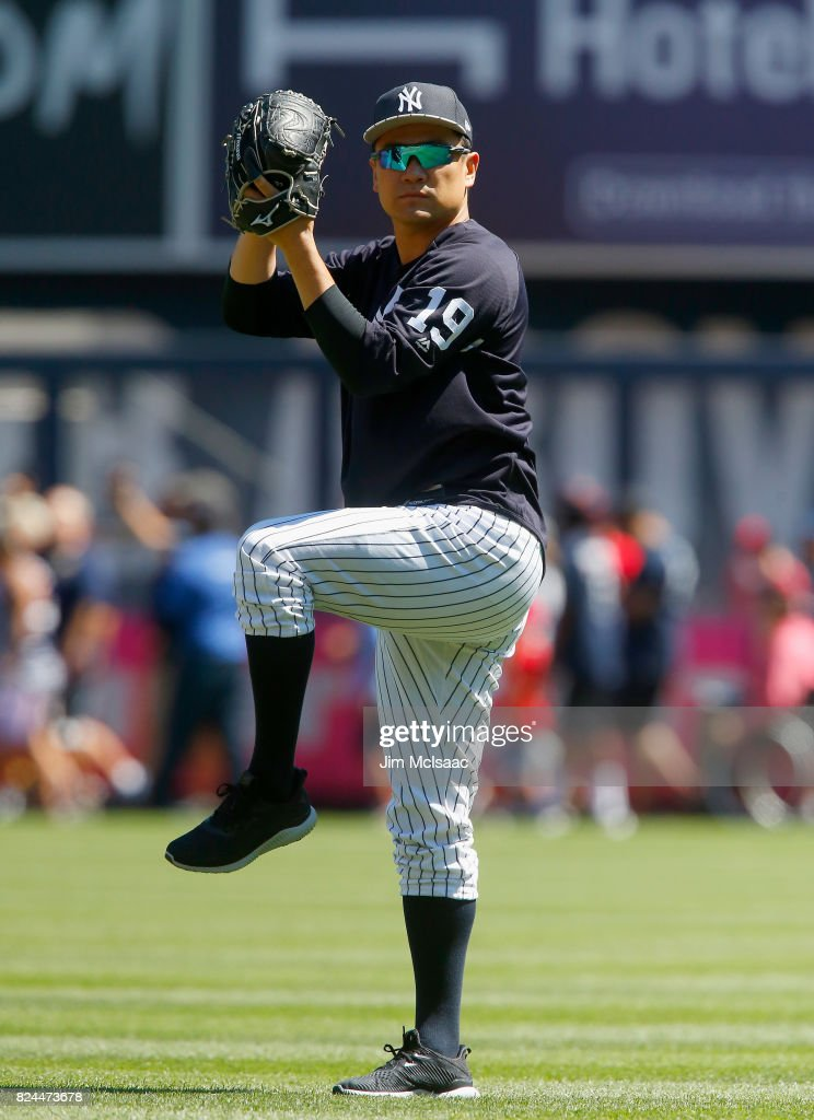 Masahiro Tanaka #19 of the New York Yankees warms up in the outfield prior to a game against the Tampa Bay Rays at Yankee Stadium on July 30, 2017 in the Bronx borough of New York City.