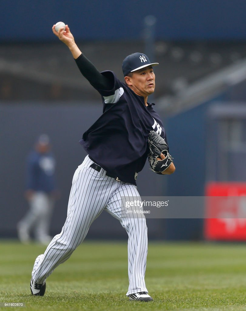 Masahiro Tanaka #19 of the New York Yankees warms up on the field prior to a game against the Tampa Bay Rays at Yankee Stadium on April 4, 2018 in the Bronx borough of New York City.
