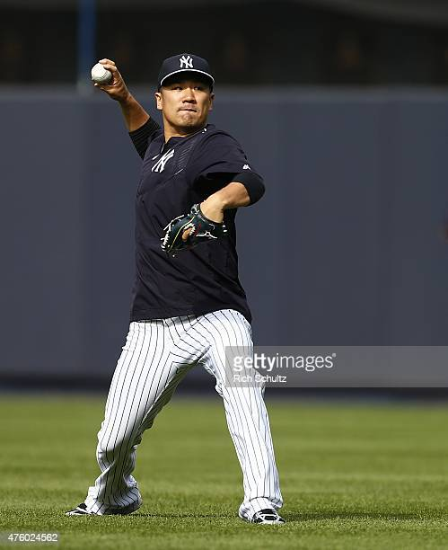 Masahiro Tanaka of the New York Yankees warms up prior to the start of a MLB baseball game against of the Los Angeles Angels of Anaheim at Yankee...