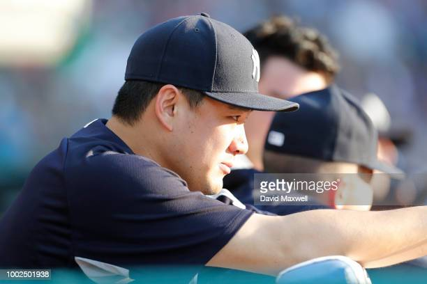 Masahiro Tanaka of the New York Yankees watches from the dugout against the Cleveland Indians during the second inning at Progressive Field on July...