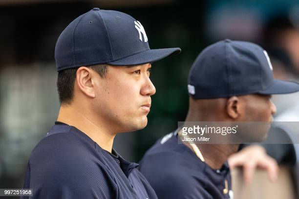 Masahiro Tanaka of the New York Yankees watches from the dugout during the third inning against the Cleveland Indians at Progressive Field on July 12...