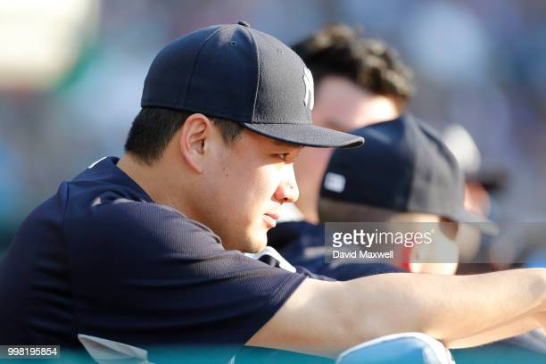 Masahiro Tanaka of the New York Yankees watches from the dugout during the second inning against the Cleveland Indians at Progressive Field on July...