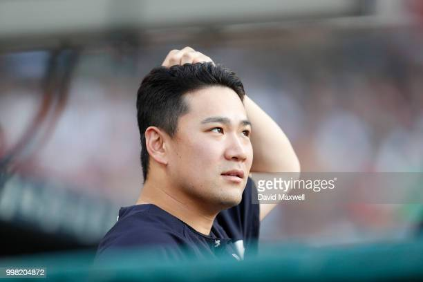 Masahiro Tanaka of the New York Yankees watches from the dugout during the third inning against the Cleveland Indians at Progressive Field on July 13...