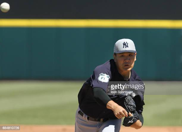 Masahiro Tanaka of the Yankees delivers a pitch to the plate during the spring training game between the New York Yankees and the Detroit Tigers on...