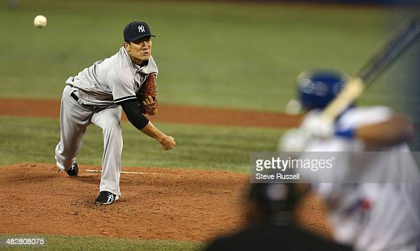 TORONTO ON APRIL 4 Masahiro Tanaka pitches to Melky Cabrera as the Toronto Blue Jays host the New York Yankees in their home opener at Rogers Centre...