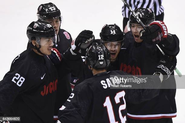 Masahito Nishiwaki of Japan celebrates scoring a goal with team mates during the men's Ice Hockey match between Japan and China on day five of the...