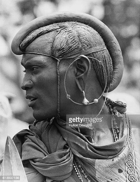 A Masai dressed to perform a ceremonial dance in honor of Princess Margaret during her 1956 tour of Tanganyika