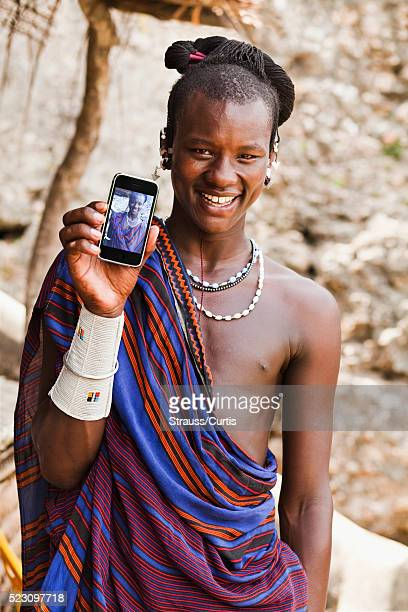 Masai man holding phone with his photograph