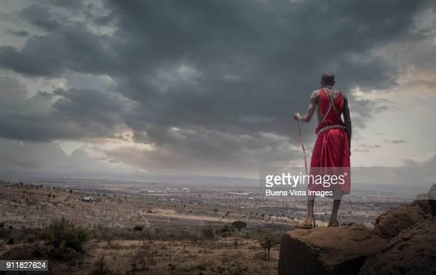 Masai Man watching urbanization.