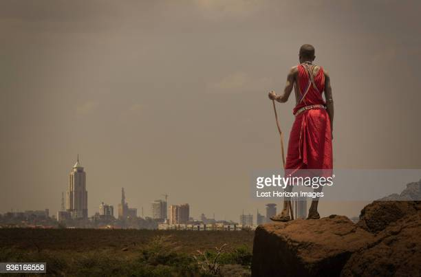 masai man with traditional dress watching nairobis skyline, nairobi, nairobi area, kenya - nairobi stock pictures, royalty-free photos & images