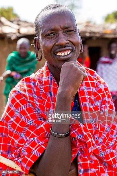 masai mara, kenya: african man with fly - eastern african tribal culture stock photos and pictures