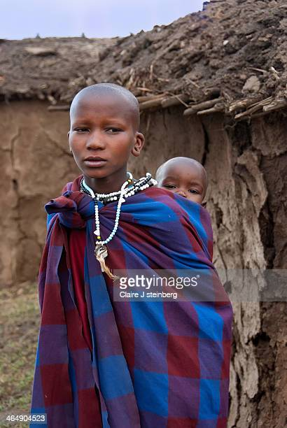 CONTENT] Masai mother and child in Tanzanian mud hut village