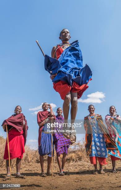 masai people performing a traditional dance. - eastern african tribal culture stock photos and pictures