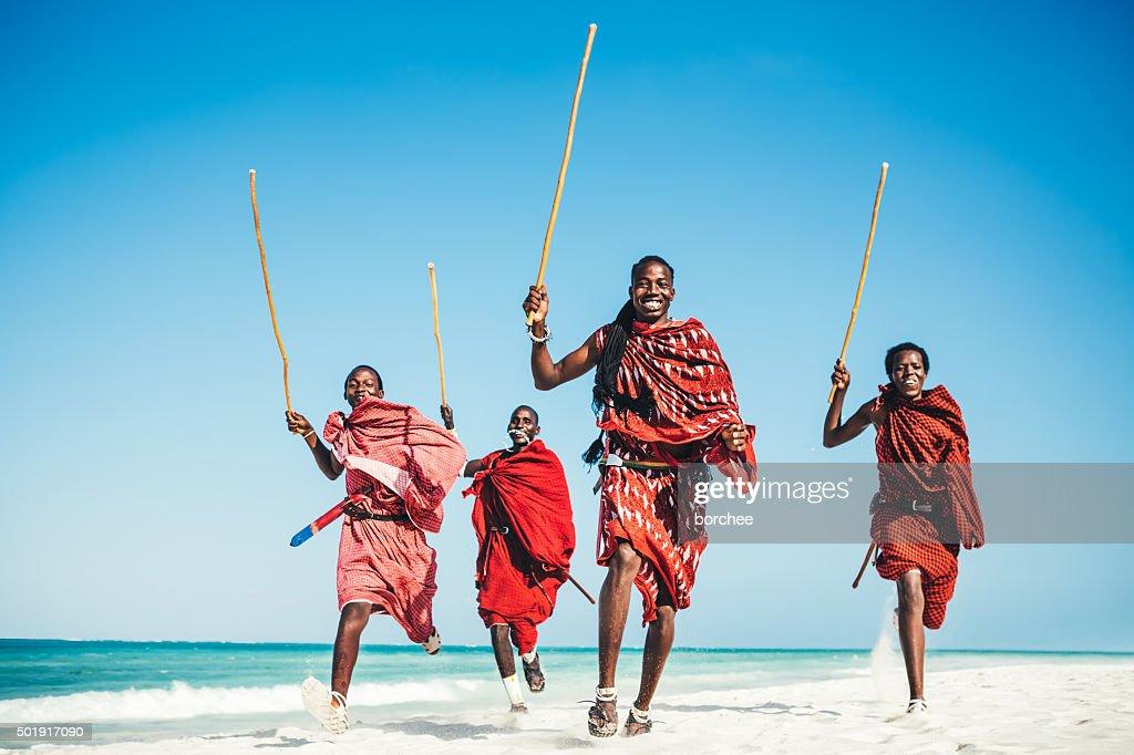 Masai People Running On The Beach.jpg : Stockfoto