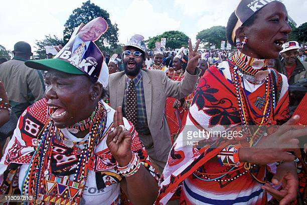 Masai supporters of NARC presidential candidate Mwai Kibaki dance and sing at a rally in honor of his return to Kenya from medical treatment in...