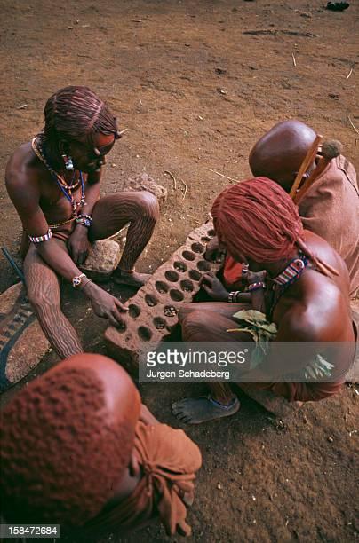 Masai tribespeople in Kenya playing a Mancala board game 1973