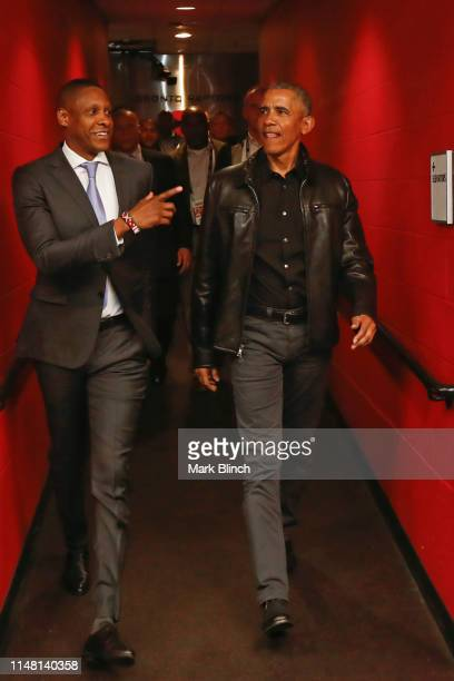 Masai Ujiri of the Toronto Raptors and the 44th President of the United States, Barack Obama walk to the court before Game Two of the NBA Finals...
