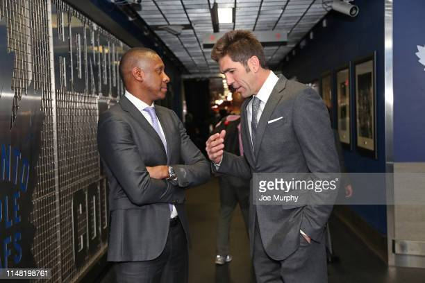 Masai Ujiri of the Toronto Raptors talks with Bob Meyers of the Golden State Warriors in the hallway before Game Two of the NBA Finals on June 2,...