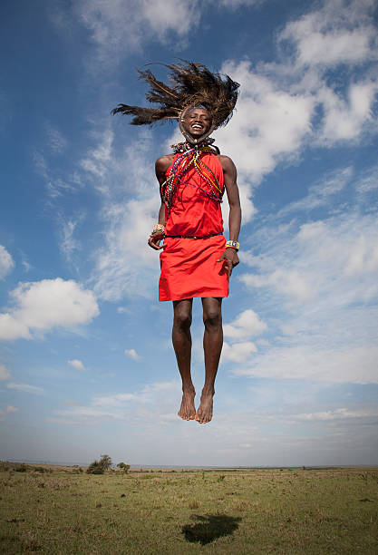 Masai warrior jumping in air