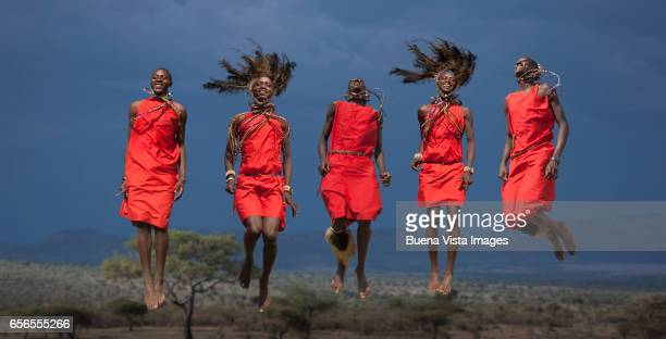 masai warriors jumping in the air while performing a masai traditional dance - traditional dancing stock pictures, royalty-free photos & images