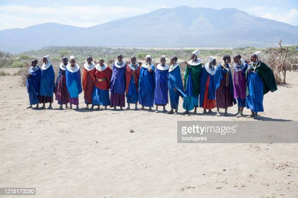 masai women  wearing traditional dress - fotofojanini foto e immagini stock