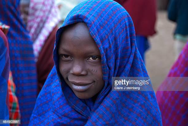 CONTENT] Masai youth in his attire in village