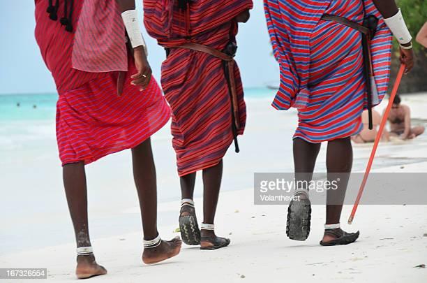 Masais walking in a popular beach in Zanzibar