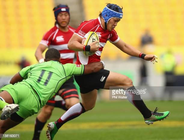 Masakatsu Hikosaka of Japan is tackled by Daniel Yakopo of Australia during the match between Japan and Australia on day two of the Wellington Sevens...