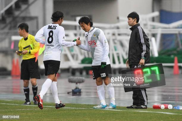 Masaki Chugo of Tokyo Verdy is replaced by Hideo Hashimoto during the JLeague J2 match between Montedio Yamagata and Tokyo Verdy at ND Soft Stadium...