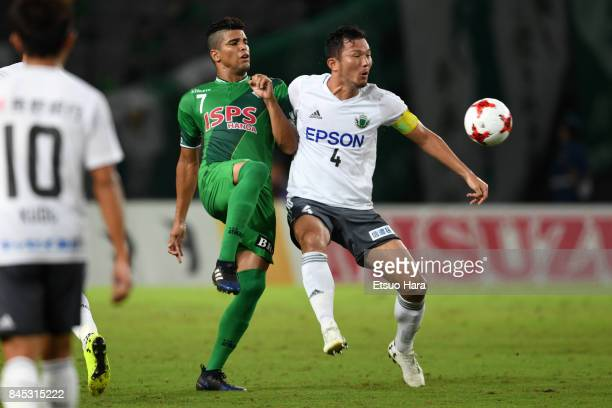 Masaki Iida of Matsumoto Yamaga and Alan Pinheiro of Tokyo Verdy compete for the ball during the JLeague J2 match between Tokyo Verdy and Matsumoto...