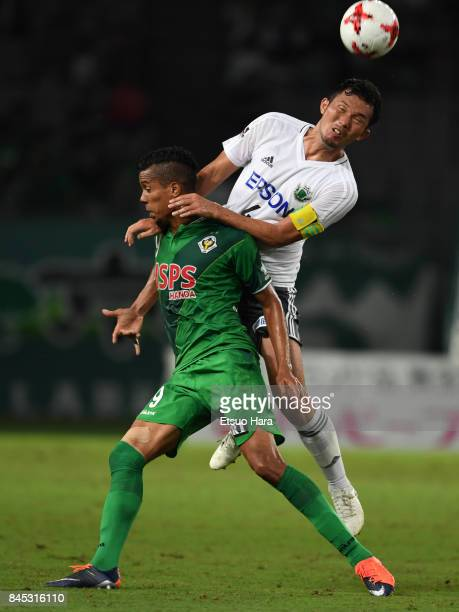 Masaki Iida of Matsumoto Yamaga and Douglas Vieira of Tokyo Verdy compete for the ball during the JLeague J2 match between Tokyo Verdy and Matsumoto...