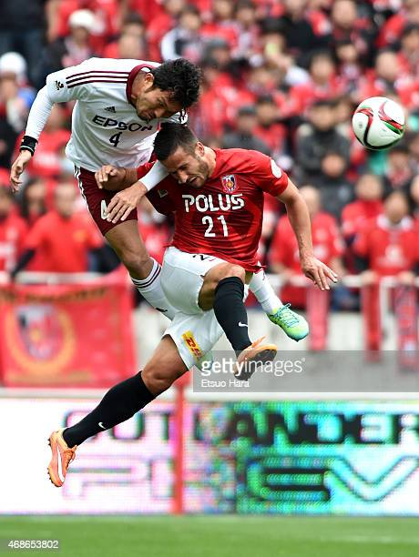 Masaki Iida of Matsumoto Yamaga and Zlatan Ljubijankic of Urawa Reds compete for the ball during the J.League match between Urawa Red Diamonds and...