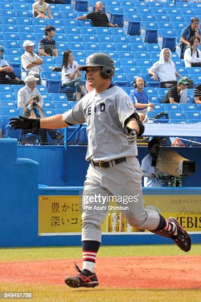 Masaki Iwami of Keio celebrates hitting a threerun homer during the Tokyo Big6 Baseball League game between Tokyo University and Keio University at...