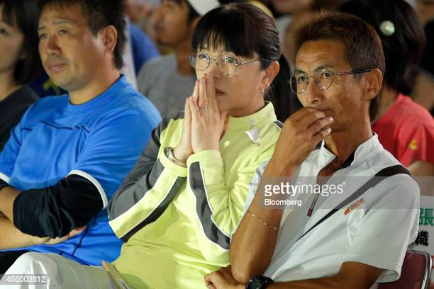 Masaki Kashiwai one of Nishikori's first coaches right and his wife Kiyomi center watch as Japan's Kei Nishikori plays against Croatia's Marin Cilic...