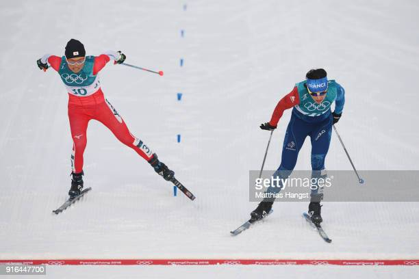 Masako Ishida of Japan and Anouk Faivre Picon of France cross the finishing line during the Ladies Cross Country Skiing 75km 75km Skiathlon on day...