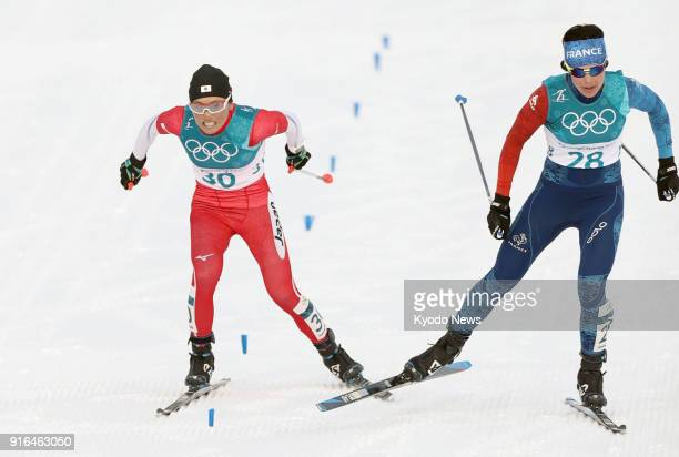 Masako Ishida of Japan and Anouk Faivre Ricon of France compete in the women's skiathlon at the Pyeongchang Winter Olympics in South Korea on Feb 10...