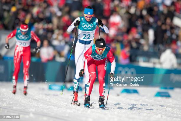 Masako Ishida of Japan and Johanna Matintalo of Finland in action during the CrossCountry Skiing Ladies' 30km Mass Start Classic at the Alpensia...