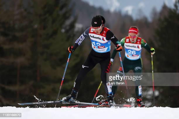 Masako Ishida of Japan and Pia Fink of Germany competes in the Women's Cross Country 30k race during the FIS Nordic World Ski Championships on March...
