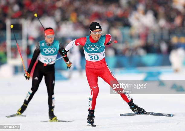 Masako Ishida of Japan competes in the women's skiathlon at the Pyeongchang Winter Olympics in South Korea on Feb 10 2018 Skiing behind her was...