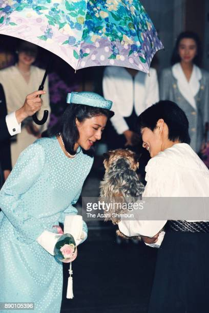 Masako Owada fiancee of Crown Prince Naruhito talks to her family pet dog Chocolat prior to the royal wedding on June 9 1993 in Tokyo Japan