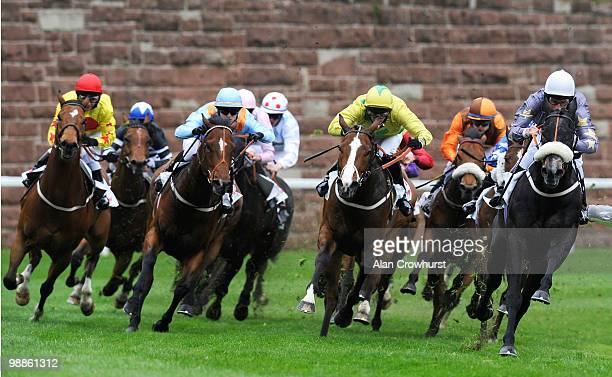Masamah and William Buick lead into the straight to win The Clatterbridge Cancer Research Handicap Stakes at Chester racecourse on May 05 2010 in...