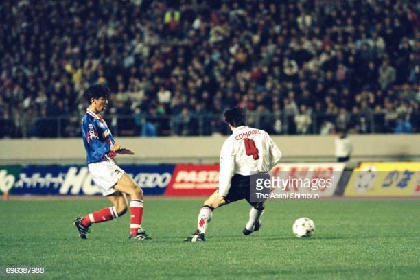 Masami Ihara of Yokohama Marinos and Masaki Tsuchihashi of Urawa Red Diamonds compete for the ball during the JLeague match between Yokohama Marinos...
