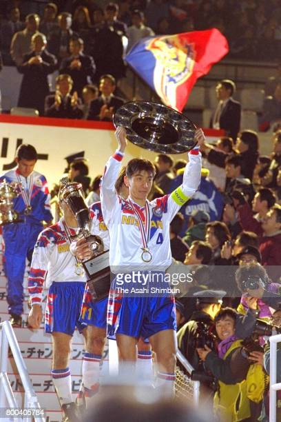 Masami Ihara of Yokohama Marinos celebrates lifts the trophy after the JLeague Championship second leg match between Verdy Kawasaki and Yokohama...